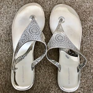 BCBGeneration Shiny Silver flip flops / sandals.